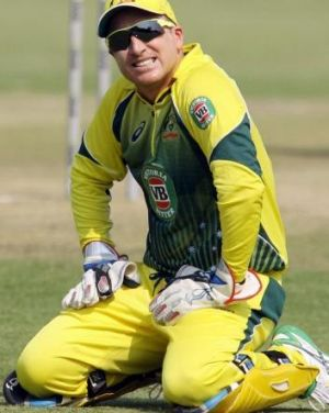 Despair: Brad Haddin misses a catching chance.
