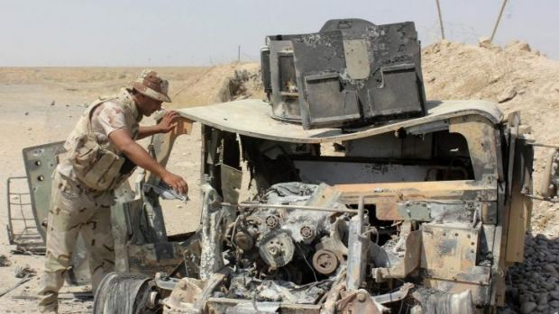 The wreckage of a Humvee used by the Islamic State militants.