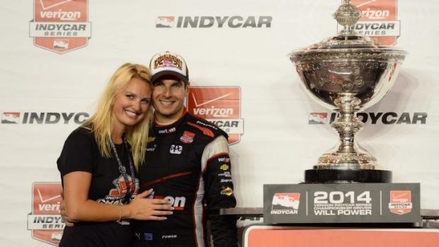 Champ: Will Power and his wife Elizabeth with the IndyCar trophy.