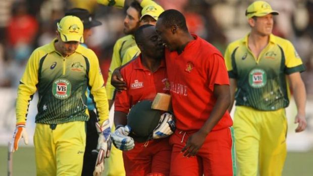 Historic: Zimbabwean batsman Prosper Utseya (left) and his teammate Tendai Chatara celebrate their team's victory over ...