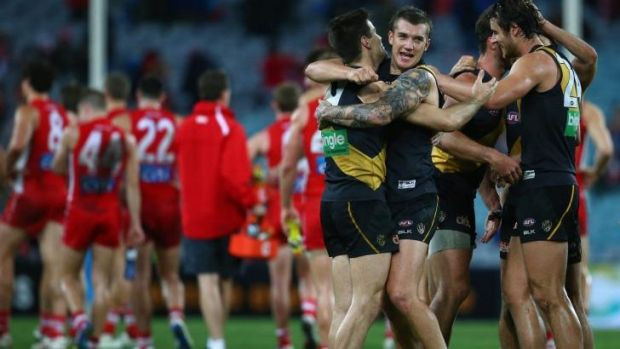 Richmond's Nathan Gordon and Dustin Martin celebrate victory over Sydney.