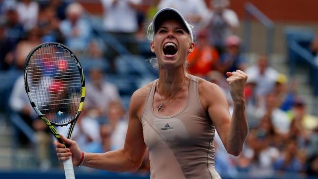 Great Dane ... Caroline Wozniacki celebrates her win over Maria Sharapova.