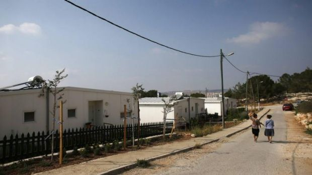 """Israeli women walk in a Jewish settlement known as """"Gevaot"""", in the Etzion settlement bloc. Israel announced a land ..."""