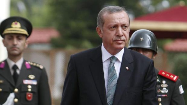 Turkey's president Recep Tayyip Erdogan inspects an honour guard during a welcoming ceremony.