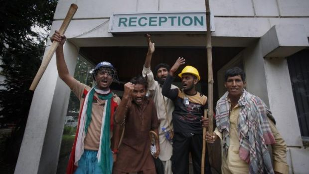 Pakistani protesters briefly shut down the state television station in Islamabad.