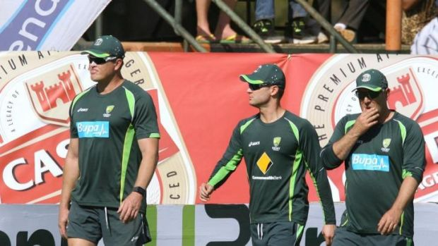 Michael Clarke and coach Darren Lehmann take a walk around the field at the Harare Sports Club.