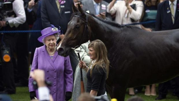 Cup runner: Queen Elizabeth with Estimate after it won the Gold Cup at Ascot last year.