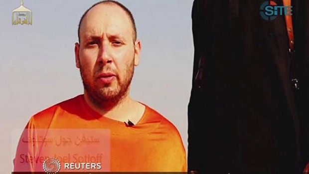 This image from video posted on the internet by Islamic State militants purports to show journalist Steven Sotloff ...
