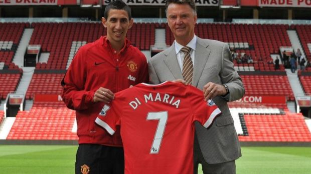 New faces: Louis van Gaal (right) with Manchester United's new signing, midfielder Angel Di Maria.