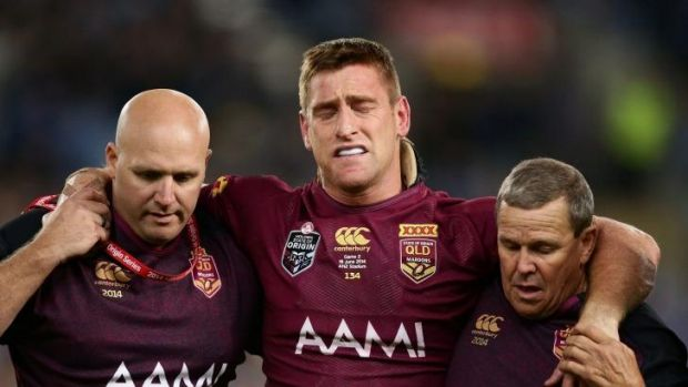 Brent Tate, centre, heads off injured in State of Origin this year.