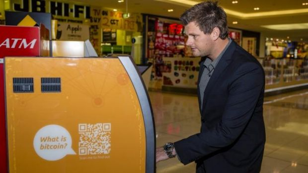 Australian Bitcoin ATMs director Robert Masters uses Canberra's first Two-Way Bitcoin ATM at the Canberra Centre.