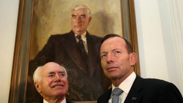 John Howard and Tony Abbott under a portrait of Sir Robert Menzies at Old Parliament House.