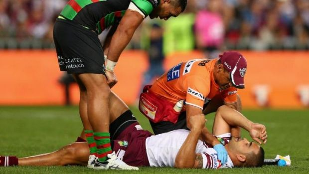 Unlucky break: Richie Fa'aoso lies on the ground after breaking his neck against South Sydney in the 2013 finals series.