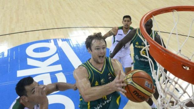 Boomers guard Brad Newley drives through the Mexico defence.