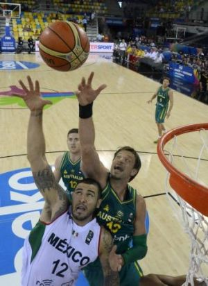 Mexican Hector Hernandez vies with Australia's David Andersen during the Boomers' eight-point World Cup win.