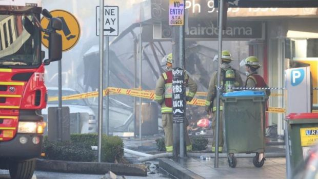Firefighters outside the Rozelle shop that was destroyed in the explosion.