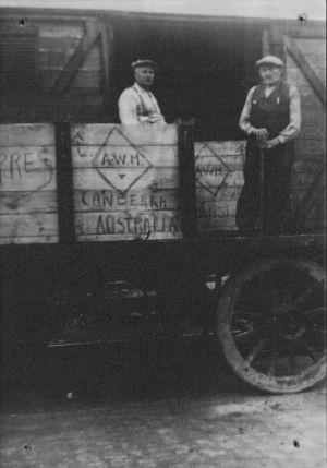 Coming to Canberra: The boxes containing the lions are loaded on a train by Ypres workmen Remi Loison and Theo Tanghe in ...