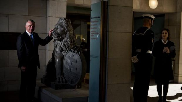 Back to Belgium: War Memorial director Brendan Nelson with the lion sculptures from Menin Gate.