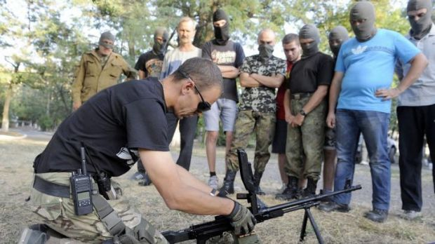 Ukrainian servicemen from the Azov Battalion train volunteers in Mariupol.