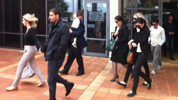 Family members of three men charged over a daylight robbery in Cabramatta leave Campbelltown Local Court on Thursday.