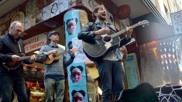 Musicians from the musical <i>Once</i> busk at Degraves Lane: (left to Right) Greg Stone, Keegan Joyce and Tom Parsons.