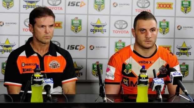 Happy days: Mick Potter and Robbie Farah front the media after the Tigers were humbled 64-6 by the Cowboys in Townsville.