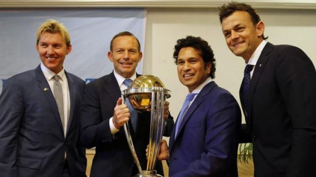 Tony Abbott, second left, holds the ICC World Cup with India's Sachin Tendulkar as they pose with Brett Lee, left and ...