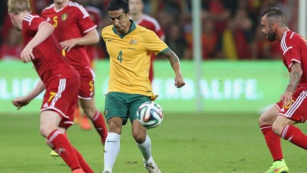 Tim Cahill of Australia chips the ball over the Belgium defenders.