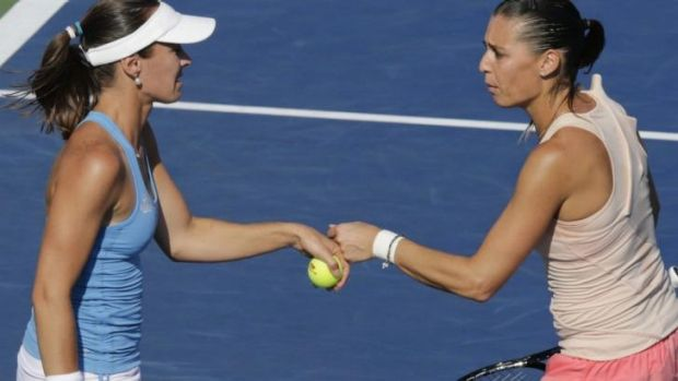 Former world No.1 Martina Hingis (L) with doubles partner Flavia Pennetta.
