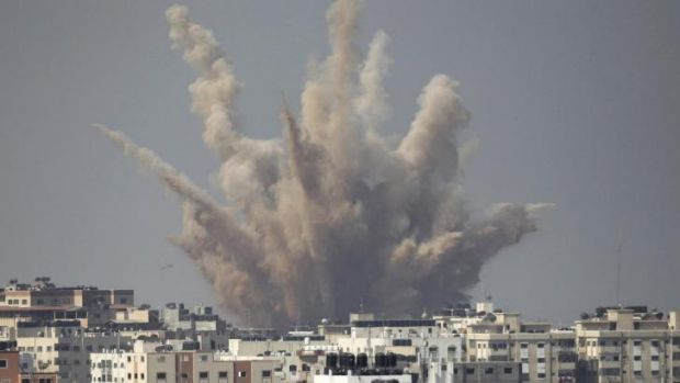 Smoke and sand are seen following what witnesses said was an Israeli air strike in August.