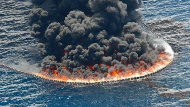 A controlled oil burn is seen near the site of the Deepwater Horizon oil spill in the Gulf of Mexico.