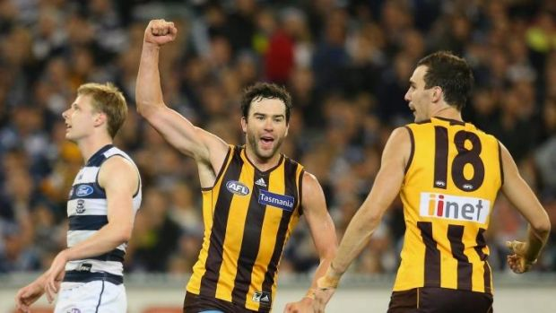 Hawthorn's Jordan Lewis celebrates after kicking a goal against Geelong at the MCG on Friday.