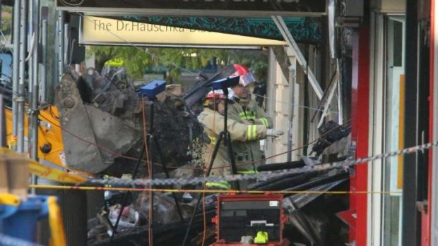 Painstaking operation: firefighters at the scene on Friday morning.