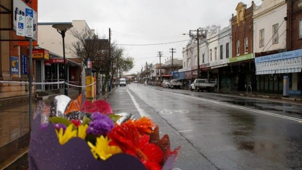 Flowers are placed close to the explosion site in Rozelle as the main street remained closed on Saturday.