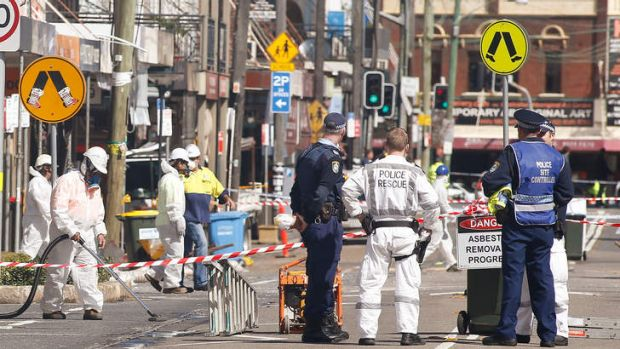 Asbestos removalists work at the scene of the explosion in Rozelle.