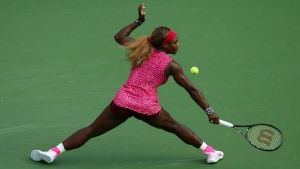 Hot shot: Serena Williams hits a return against Ekaterina Makarova in their US Open semi-final.