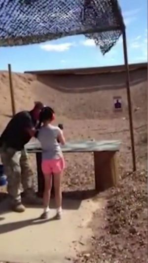 TRAGIC: Shooting instructor Charles Vacca stands next to the 9-year-old girl at the Last Stop shooting range at Bullets ...