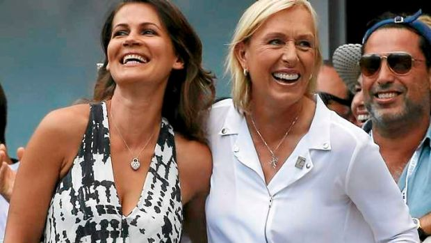 Tennis great Martina Navratilova (right) and her partner Julia Lemigova celebrate after getting engaged at the US Open.