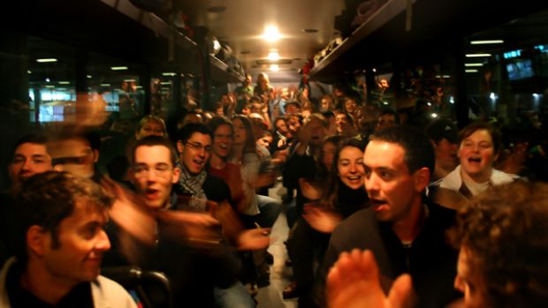 Unfazed: Pilgrims from France  were not deterred by the   bone-rattling bus ride  for Sydney.  PICTURE: JUSTIN McMANUS