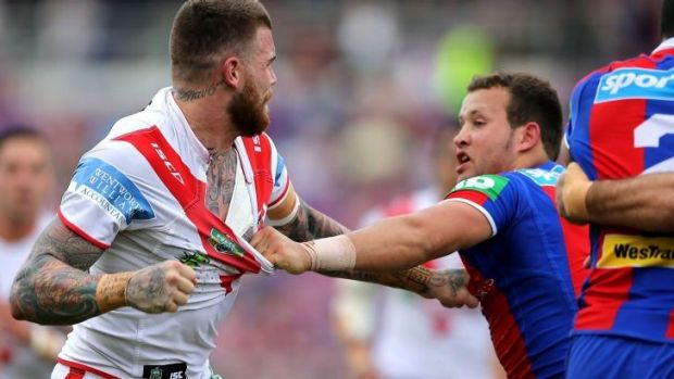 Brouhaha: Josh Dugan of the Dragons and Newcastle's Tyrone Roberts let loose at Hunter Stadium.