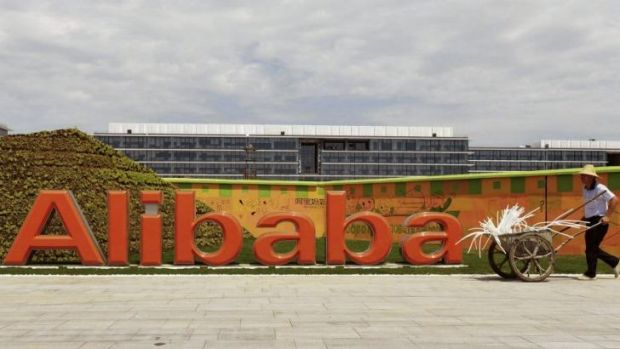 A worker walks past the Alibaba headquarters on the outskirts of Hangzhou, Zhejiang province, China.