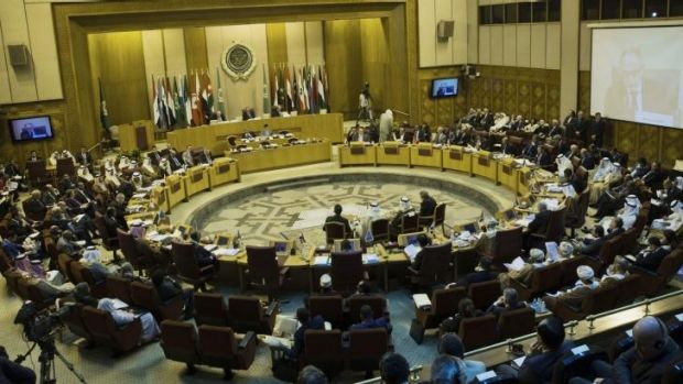 Foreign ministers take their seats at the Arab League headquarters in Cairo on Sunday.