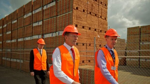 Tony Abbott tours the Sydney plant of Brickworks with its managing director, Liberal donor Lindsay Partridge, in ...