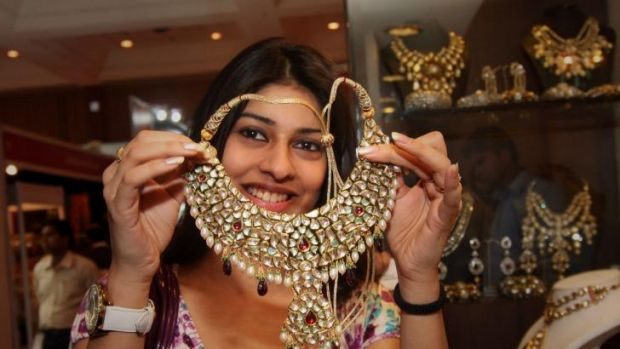 Despite the upcoming Indian wedding season, slowing demand from China is weighing on the spot price of gold.