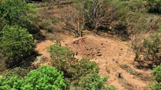 A photo provided by the Nicaraguan Army shows an impact crater made by a small meteorite in a wooded area near Managua's ...