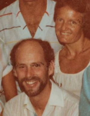 Father Knowles with Ms Herrick at a housewarming party about 1981.