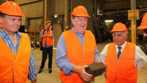 Brickworks managing director Lindsay Partridge, left, with the then opposition leader Barry O'Farrell, at Austral ...