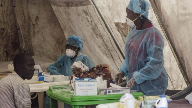 Health workers take blood samples for Ebola testing at a screening tent in the local government hospital in Kenema, ...