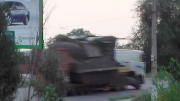 A truck the Ukrainian Interior Ministry said was carrying a Buk missile launcher, apparently minus one of its missiles, ...