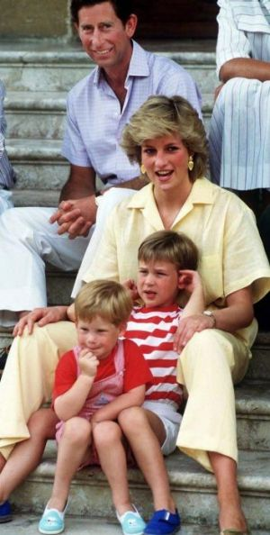 'Her love for them was almost obsessive': The Prince and Princess of Wales on holiday with their children in 1987.